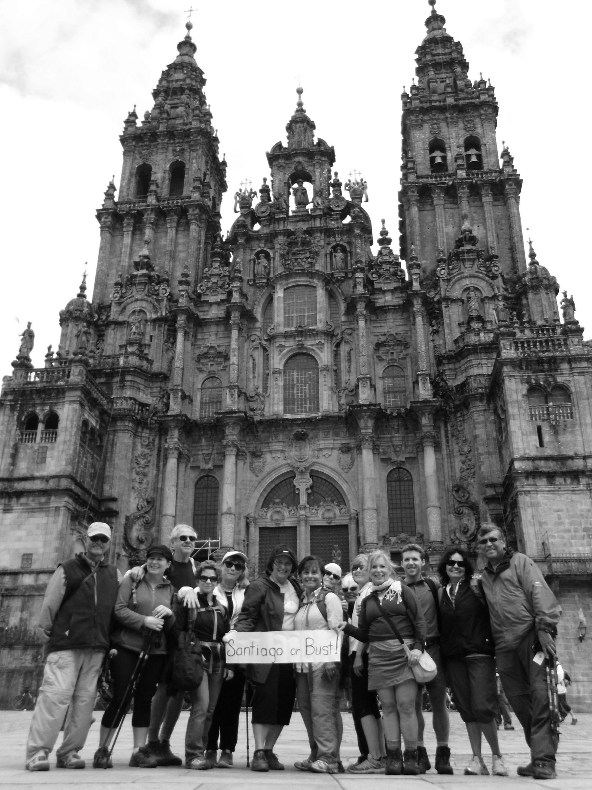 TRAVELERS walk The Way of St. James for a variety of reasons — religious, cultural, personal. Here a group celebrates reaching the conclusion of The Way, Compestela de Santiago. Courtesy photos