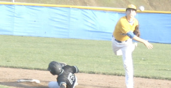 BENICIA SHORTSTOP Anthony Fellman turns a double play against Rodriguez.