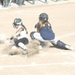 SPSV'S NATALYA OCON slides home with a run past Pinole Valley catcher Angel Turner.