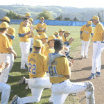 BENICIA MANAGER Jim Bowles praises his baseball team after a 18-0 thumping of Vallejo on Thursday.