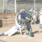 BENICIA'S ALANA COMBES (8) slides home with the go-ahead run in the fourth inning.