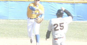 BENICIA SHORTSTOP Caleb Van Blake (left) tries to turn a double play as Fairfield's Steve Arias (25) comes sliding in to break things up.