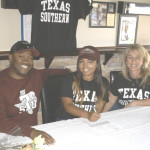 BENICIA SENIOR Chanler Powell (center) signs a letter of intent to play softball for Texas Southern University during a signing ceremony last Saturday at Rookies Sports Bar & Grill in Benicia. Pictured with Chanler are her father (Chris) and mother (Shandrika).