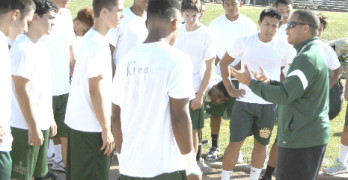 NEW SPSV varsity football head coach Lane Hawkins (right) is conditioning his small squad of Bruins for a grueling 2014 season.