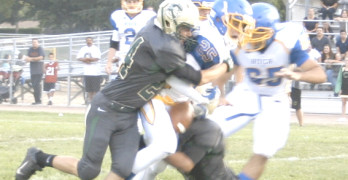 BENICIA RUNNING BACK Alex Osterholt has the ball stripped by the Concord defense.