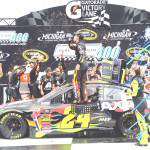 JEFF GORDON celebrates in Victory Lane after winning the NASCAR Sprint Cup Series Pure Michigan 400 at Michigan International Speedway on Sunday.