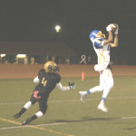 BENICIA'S JASON SHELLEY hauls in a 29-yard pass against Bethel at Corbus Field.