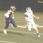 BENICIA QUARTERBACK Riley Pitkin (right) scrambles away from pressure against Inderkum in Friday night's playoff game in Sacramento.