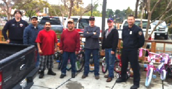 BICYCLES accepted by Benicia firefighters, from employees of Benicia Fabrication, on Dec. 18. Courtesy photo
