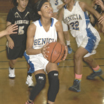 KAMERON HATCHER of Benicia goes strong to the basket against visiting American Canyon.