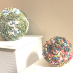 "AT LEFT, Marty Jonas's ""Bowling Ball""; right, ""Crocheted Ball."" Photo by Keri Luiz/Staff"