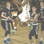 B.J. STANDLEY leaps through traffic in SPSV's North Coast Section semifinal playoff game against Marin Catholic.