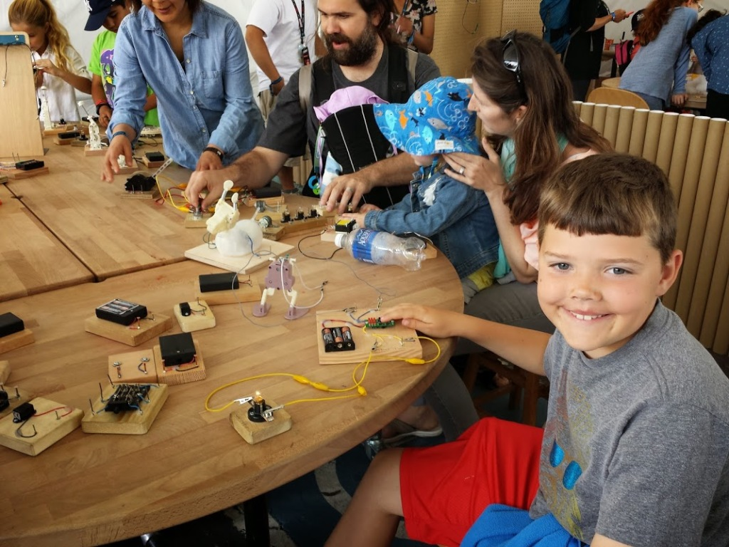 JAMES NEWCOMB tests homemade circuits at Bay Area Maker Faire. Aaron Newcomb photos