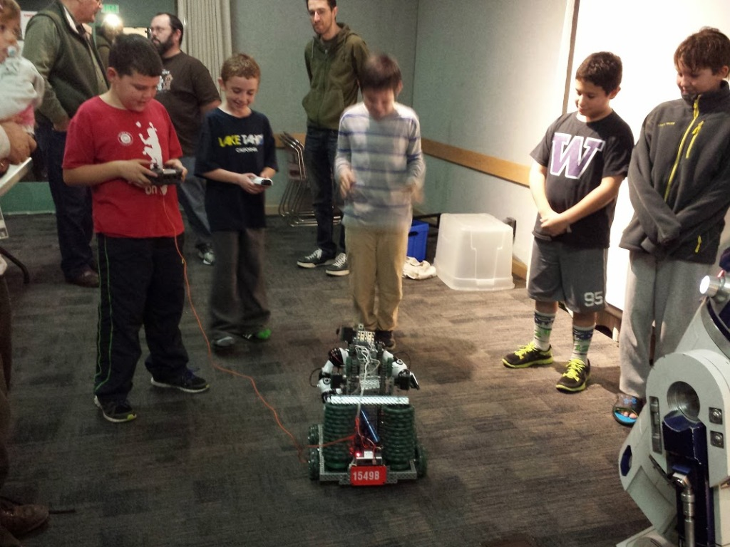 JAMES NEWCOMB and Wyatt and Patrick Carvalho practice robot driving skills at a Benicia Makerspace workshop. Aaron Newcomb photos
