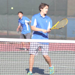 NICK MENJIBAR (foreground) waits for doubles teammate Brian Hung to rip a volley against Bethel.