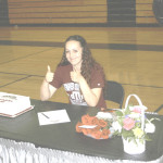 CASSIDY JANNSON gives two thumbs up after signing a full-ride scholarship to play volleyball for Texas Southern University in Houston after graduating Benicia High.