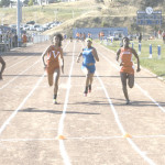BENICIA HIGH'S Milyan White (far left) wins the varsity girls 100 meters as teammates Kameron Hatcher (middle) and Britiana Fields-Strother (far right) compete in Wednesday's finals.