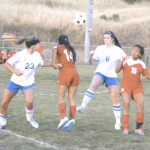 BENICIA HIGH'S Katie Lovelace (8) and Sara Hingley (23) battle Ceres captain Angelica Slater (15) and defender Karina Torrez (14) for a loose ball at Drolette Stadium.