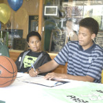RYAN STEWART signs a letter of intent to play basketball for Whitman College after graduating from SPSV.
