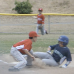CADE ZIELSTORFF of the Mariners slides into third just ahead of the tag by Phillies third baseman Bryce Colaizzi.