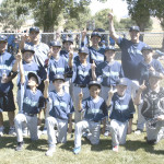 THE MARINERS held on for a thrilling 6-4 victory over the Phillies and captured the Benicia Little League Majors World Series title. The Mariners are (standing from left) coach Ron Maio, Cade Zielstorff, manager Al Zielstorff, Connor Maio, P.J. Morgan, R.J. Cabral, Simon Place, Gabe Haaberg, coach Steve Naratil, Brandon Nelson; (kneeling from left) Jack Castillo, Domini Naratil, Dylan Villanueva, Bryce Eldridge and T.J. Valentine.
