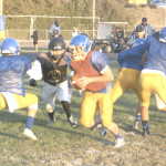 BENICIA QUARTERBACK Riley Pitkin gets ready to roll out during Saturday's scrimmage.