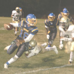 BENICIA QUARTERBACK Devin Holden (16) tries to get away from Concord defenders.