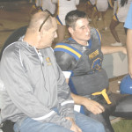BENICIA QUARTERBACK Riley Pitkin (right) sits with trainer Scott Corbin after suffering a mild concussion against Concord last week. Pitkin is out for Friday's home game against McClymonds.