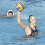 MICAH BAIRD gets ready to unload a shot against Fairfield at Cunningham Pool on Monday.