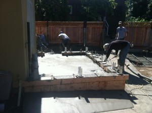 Construction workers set up the foundation for the Cabana, the outdoor bar which will be the centerpiece of Lucca Bar & Grill's new beer garden. (Photo courtesy of Marty Duvall)