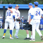 BENICIA PITCHER Anthony Lopez (23) gets congratulated by teammates after his three-hitter sent the Panthers to the Sac-Joaquin Section Division II championship game.