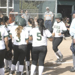 JAYDEE BOURSAW (22) gets met at home plate by her SPSV teammates after hitting a mammoth two-run homer in Tuesday's North Coast Section playoff opener.