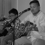Noah and Nico Luciano, Mark Kennedy's students, strum their guitars as they play a tune together. (Courtesy photo)