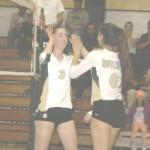 LADY BRUINS Candice Turk (left) and Caroline Gallagher celebrate a point against El Cerrito.