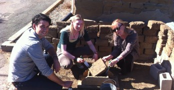"""CAN YOU DIG IT?: (Left to Right) UC Berkeley archaeology graduate student David Hyde, Benicia Historical Museum Office Manager Katelynn Burmark and museum Executive Director Elizabeth D'Huart build Adobe bricks, one of the many activities to be offered at next weekend's """"I Dig Benicia!"""" event, in which children can uncover Benicia's past through excavation. (Photo by Nick Sestanovich)"""