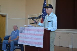 World War II veteran Bob Hitchcock (Right) holds up a model of the B-17 plane he served on during a presentation at LIberty High School where he told stories of his time in the war. Harold Bray (Left, seated) also recounted his experiences. (Photo by Nick Sestanovich)