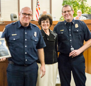 (Far left) Benicia Fire Department firefighter and paramedic Wayne Fraser is honored by Mayor Elizabeth Patterson (Center) and Acting Deputy Chief Josh Chadwick at Tuesday's City Council meeting. (Photo by Kate Gibbs)