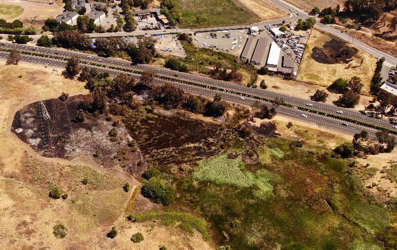 Numerous agencies respond to third-alarm vegetation fire off